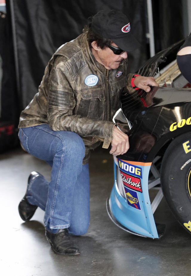 Team owner Richard Petty looks over the car of Darrell Wallace Jr. in the garages during NASCAR auto race practice at Daytona International Speedway, Saturday, Feb. 9, 2019, in Daytona Beach, Fla. (AP Photo/John Raoux)