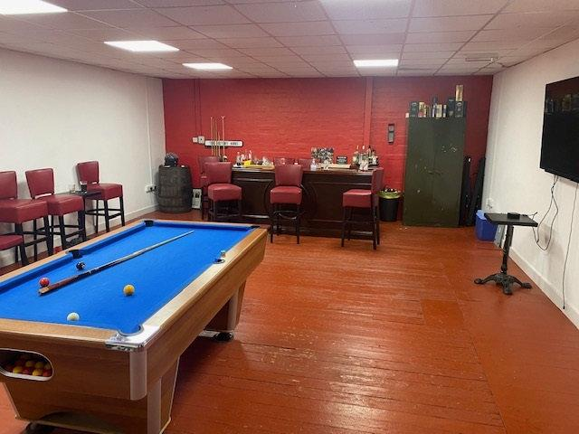 Seven men have been fined £200 each after they were caught drinking in a pop-up pub - complete with a pool table, beer taps and football on the TV (swns)