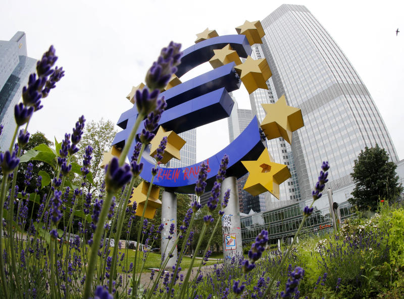 The euro sculpture stands in front of the European Central Bank, ECB, in Frankfurt, Germany, Tuesday, June 11, 2013. A key ECB program that has been credited with calming the 3 1/2 year-old euro debt crisis faced a legal challenge Tuesday in Germany's highest court. The Federal Constitutional Court in Karlsruhe is considering arguments against the ECB's offer to buy government bonds and lower borrowing costs for indebted countries. Opponents of the bond-buying program say the program oversteps the ECB's mandate, which forbids it from financing governments. (AP Photo/Michael Probst)