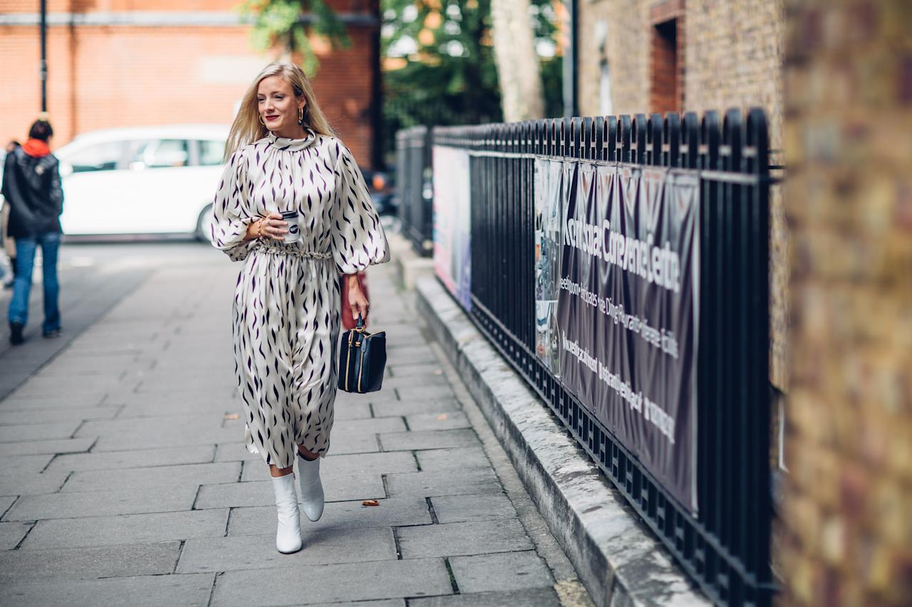 <p>One of Fashion Month's most recognisable faces, Kate Foley, opted for a printed dress and white boots on day three of London Fashion Week. </p>