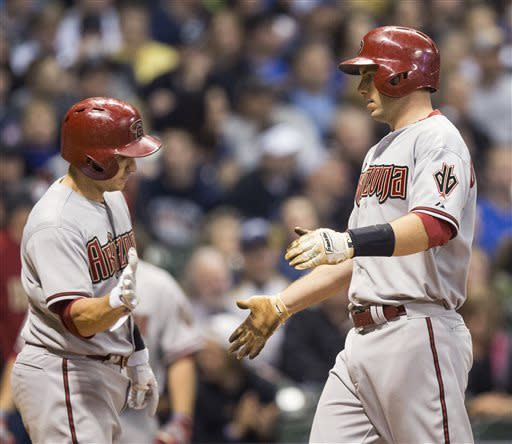 Arizona Diamondbacks' Paul Goldschmidt, right, is greeted by Miguel Montero after hitting a two-run home run off Milwaukee Brewers' Mike Fiers during the fifth inning of a baseball game Saturday, April 6, 2013, in Milwaukee. (AP Photo/Tom Lynn)
