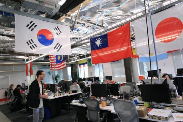Employees work in the international user operations area at the new headquarters of Facebook in Menlo Park, January 11, 2012.