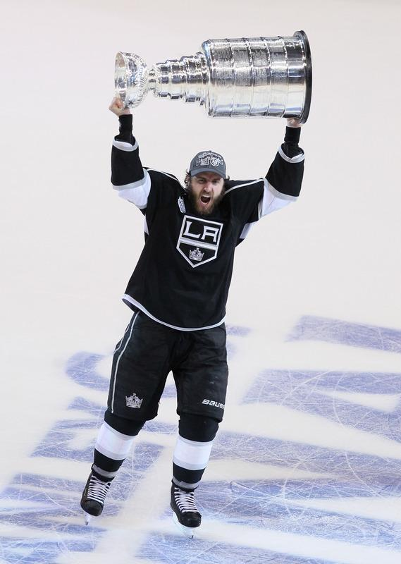 LOS ANGELES, CA - JUNE 11: Mike Richards #10 of the Los Angeles Kings holds up the Stanley Cup after the Kings defeated the New Jersey Devils 6-1 to win the Stanley Cup series 4-2 after Game Six of the 2012 Stanley Cup Final at Staples Center on June 11, 2012 in Los Angeles, California. (Photo by Jeff Gross/Getty Images)
