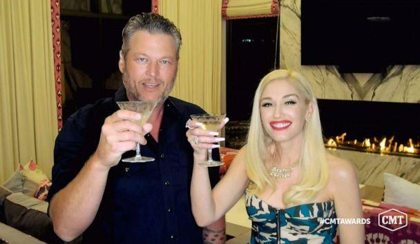 PHOTO: In this video image provided by CMT, Blake Shelton and Gwen Stefani toast as they accept the collaboration of the year award for 'Nobody But You' during the Country Music Television awards airing on Oct. 21, 2020. (CMT via AP)