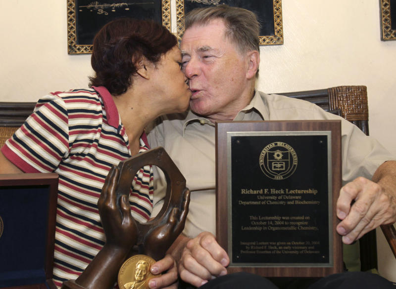American Richard Heck and his Filipino wife Socorro, kiss during an interview with the Associated Press at their residence at Manila's Quezon city in the Philippines shortly after The Royal Academy of Sciences announced in Sweden he won the 2010 Nobel Prize in Chemistry Wednesday Oct.6, 2010. Heck, a long-time resident in the Philippines and married to a Filipino,  and Japanese researchers Ei-ichi Negishi and Akira Suzuki won the Nobel Prize for developing a chemical method that has allowed scientists to test cancer drugs and make thinner computer screens.  (AP Photo/Bullit Marquez)