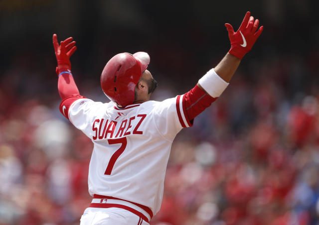 Cincinnati Reds' Eugenio Suarez (7) reacts as he crosses home plate with a solo home run off St. Louis Cardinals starting pitcher Jack Flaherty during the first inning of a baseball game, Sunday, Aug. 18, 2019, in Cincinnati. (AP Photo/Gary Landers)