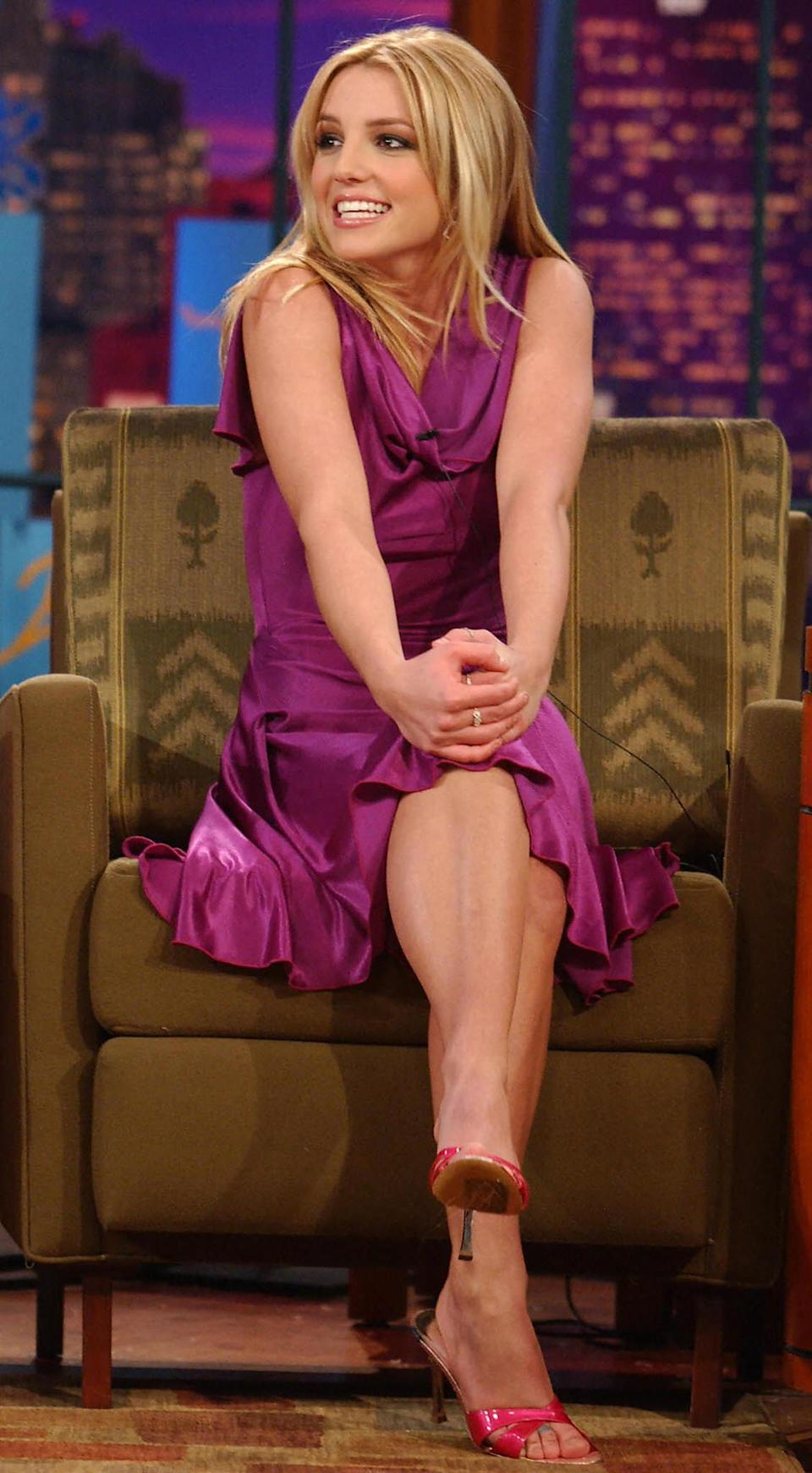 Britney smiling while appearing on a late night talk show