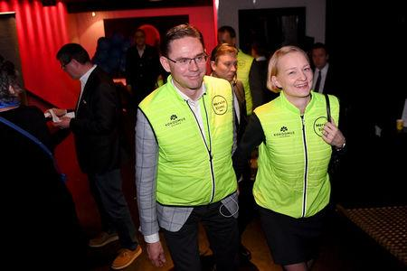 European Commission Vice-President and commissioner for Jobs, Growth, Investment and Competitiveness Jyrki Katainen and wife, parliamentary election candidate Mervi Katainen, attend the National Coalition Party's election party in Helsinki