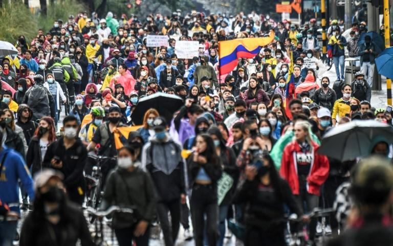 Demonstrators protest against a tax reform proposed by Colombian President Ivan Duque's government