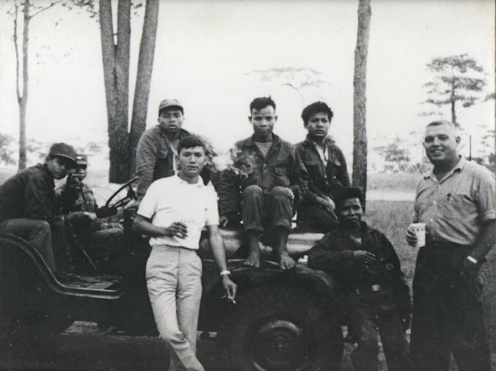 """Tom Hewitt (right) with his """"road-watch"""" team in Laos during his posting there from 1966 to 1968 during the CIA's secret war. The team's mission was to report on the Ho Chi Minh trail, which the North Vietnamese used to supply their forces in South Vietnam. (Photo: Courtesy Hewitt family)"""