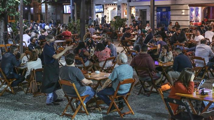 Customers enjoy a bar in Tijuca neighbourhood on the second day after the opening of bars and restaurants