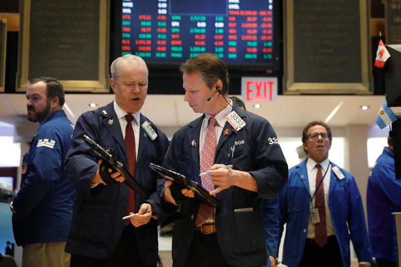 FILE PHOTO - Traders work on the floor of the New York Stock Exchange shortly after the opening bell in New York, U.S., February 21, 2018. REUTERS/Lucas Jackson