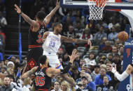 Oklahoma City Thunder guard Terrance Ferguson(23) passes the ball around Chicago Bulls center Wendell Carter Jr. (34) and Denzel Valentine (45) in the first half of an NBA basketball, Monday, Dec. 16, 2019, in Oklahoma City. (AP Photo/Kyle Phillips)