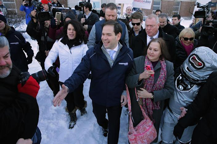 <p>Sen. Marco Rubio shakes hands while thanking supporters outside a polling place at Webster School in Manchester, N.H., on Feb. 9, 2016.<i> (Photo: Chip Somodevilla/Getty Images)</i></p>