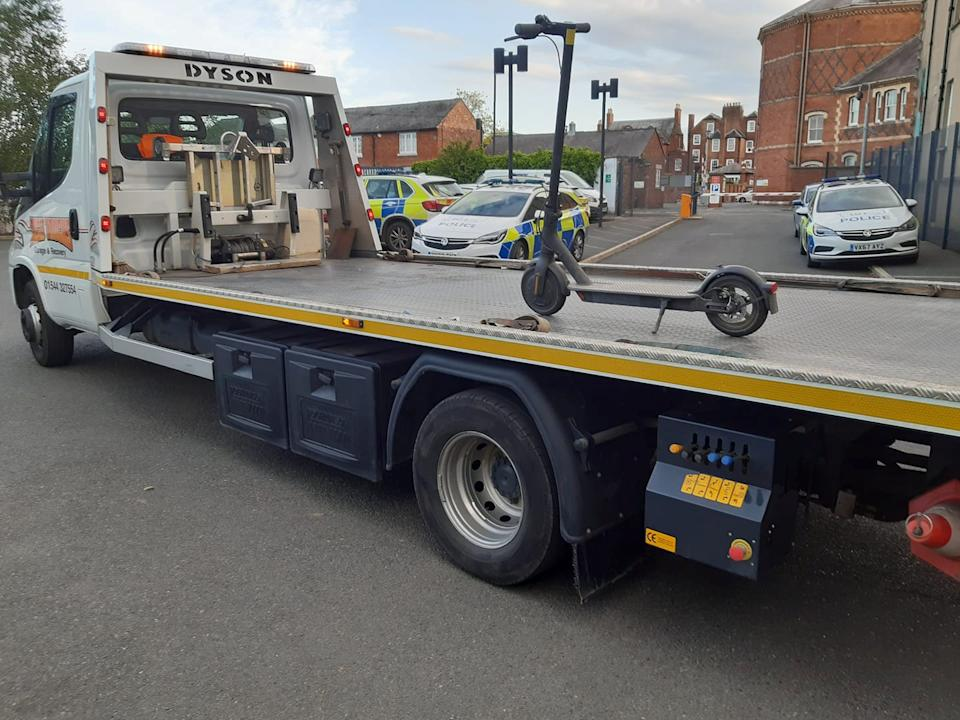 A police force has been mocked on social media for using a 7.5 tonne recovery truck to tow away an electric scooter. (SWNS)