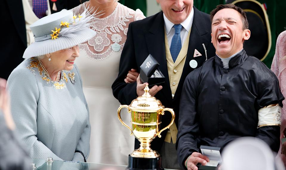 ASCOT, UNITED KINGDOM - JUNE 20: (EMBARGOED FOR PUBLICATION IN UK NEWSPAPERS UNTIL 24 HOURS AFTER CREATE DATE AND TIME) Queen Elizabeth II presents jockey Frankie Dettori with his prize after he rode 'Stradivarius' to victory in the Gold Cup on day three, Ladies Day, of Royal Ascot at Ascot Racecourse on June 20, 2019 in Ascot, England. (Photo by Max Mumby/Indigo/Getty Images)