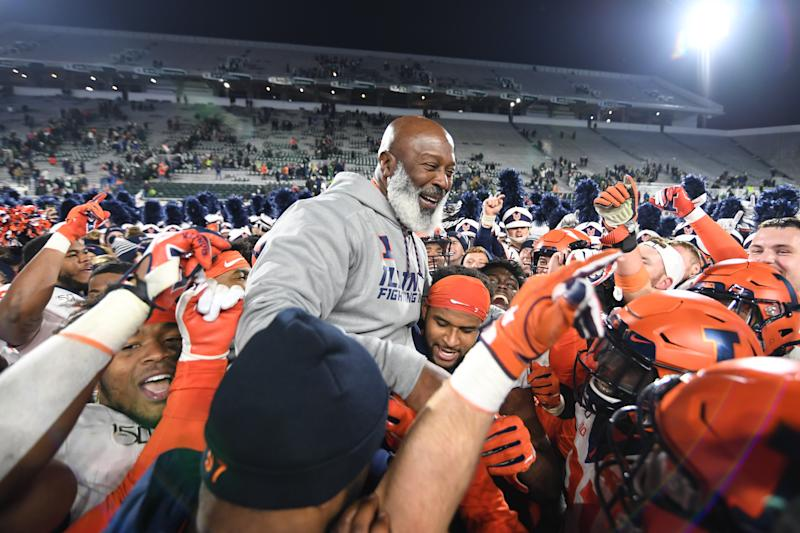 EAST LANSING, MI - NOVEMBER 09: Members of Illinois football team pick coach Lovie Smith up on their shoulders following a college football game between the Michigan State Spartans and Illinois Fighting Illini on November 9, 2019 at Spartan Stadium in East Lansing, MI. (Photo by Adam Ruff/Icon Sportswire via Getty Images)