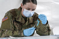 U.S. Army medic Kristen Rogers of Waxhaw, N.C. fills syringes with the Johnson & Johnson COVID-19 vaccine, Wednesday, March 3, 2021, in North Miami, Fla. FEMA opened four mass vaccinations sites in Florida capable of vaccinating up to 3,000 people a day, seven days a week. (AP Photo/Marta Lavandier)