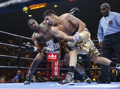 Adrien Broner avoids a punch from John Molina Jr. during their junior welterweight boxing match Saturday. (AP Photo/Eric Jamison)