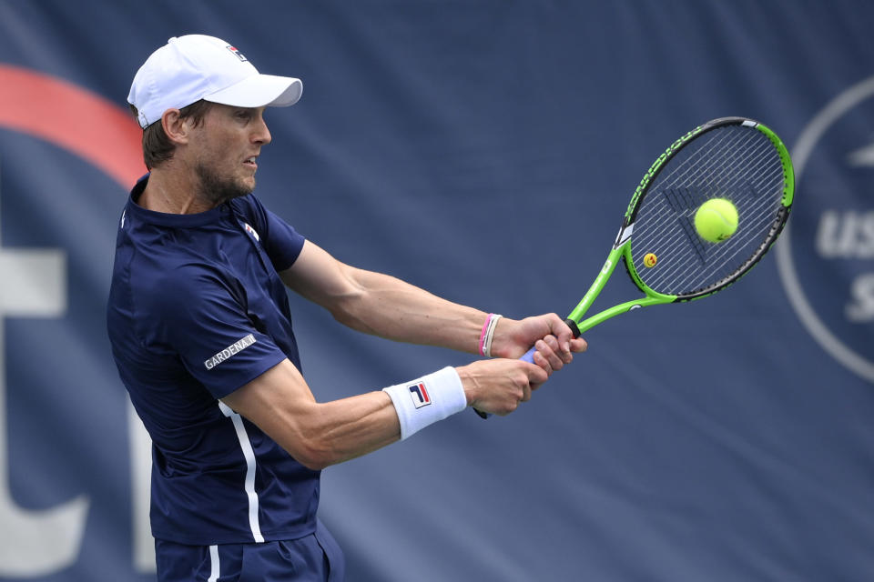 Andreas Seppi, of Italy, returns a shot against Yasutaka Uchiyama, of Japan, during a match in the Citi Open tennis tournament, Monday, Aug. 2, 2021, in Washington. (AP Photo/Nick Wass)
