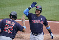 Cleveland Indians' Harold Ramirez, right, celebrates with Josh Naylor after hitting a solo home run during the fifth inning of a baseball game in Pittsburgh, Sunday, June 20, 2021. (AP Photo/Gene J. Puskar)