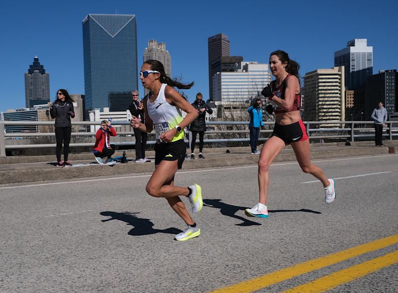 ATLANTA, GEORGIA - FEBRUARY 29: Des Linden and Laura Thweatt race during the U.S. Olympic marathon team trials on February 29, 2020 in Atlanta, Georgia. (Photo by Andy Kiss/Getty Images)