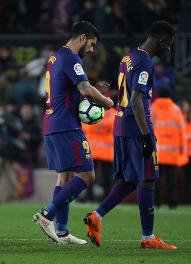 Soccer Football - La Liga Santander - FC Barcelona vs Girona - Camp Nou, Barcelona, Spain - February 24, 2018 Barcelona's Luis Suarez with the match ball, due to completing a hat trick, at the end of the match with Ousmane Dembele REUTERS/Sergio Perez