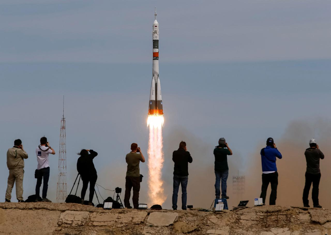 <p>Photographers take pictures as the Soyuz MS-04 spacecraft carrying the crew of Jack Fischer of the U.S. and Fyodor Yurchikhin of Russia blasts off to the International Space Station (ISS) from the launchpad at the Baikonur Cosmodrome, Kazakhstan, April 20, 2017. (Shamil Zhumatov/Reuters) </p>