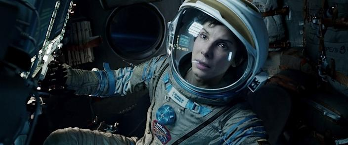 """This film image released by Warner Bros. Pictures shows Sandra Bullock in a scene from """"Gravity."""" This year's best picture race at the 86th Academy Awards on Sunday, March 2, 2014, has shaped up to be one of the most unpredictable in years. The favorites are """"12 Years a Slave,"""" """"Gravity"""" and """"American Hustle."""" (AP Photo/Warner Bros. Pictures, File)"""