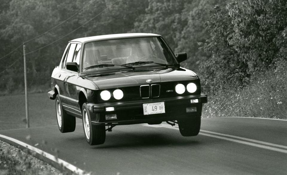 """<p>BMW's first ever M5 was fast, handled well, and helped launch the automaker's M division into the mainstream. But who cares about all of that? Here's that original M5 with its suspension at full droop during <a href=""""http://www.caranddriver.com/reviews/1987-bmw-m5-road-test-review"""" rel=""""nofollow noopener"""" target=""""_blank"""" data-ylk=""""slk:our first test of the sports sedan"""" class=""""link rapid-noclick-resp"""">our first test of the sports sedan</a> in 1987.</p>"""