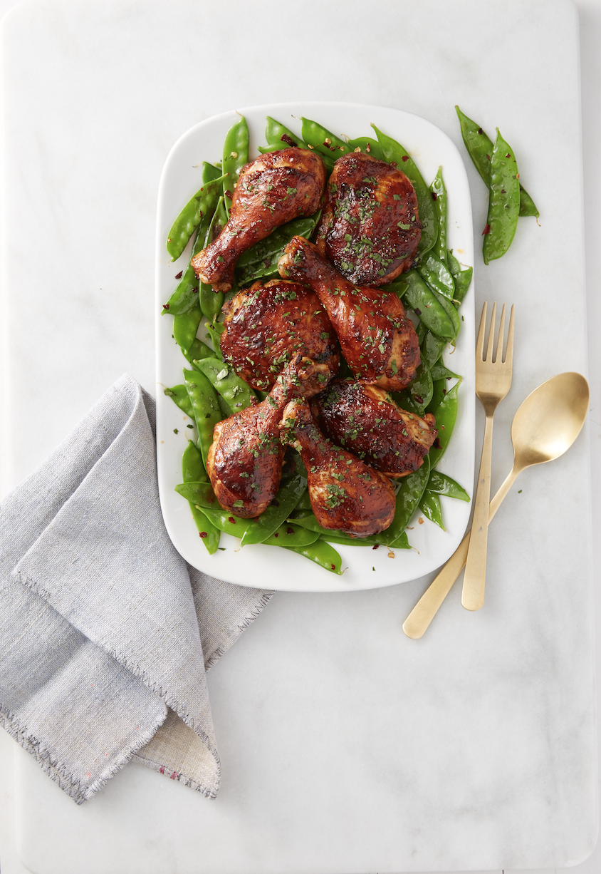 """<p>Hoisin sauce turns average drumsticks into an addicting dinner.</p><p><em><a href=""""https://www.goodhousekeeping.com/food-recipes/a38402/sweet-sticky-chicken-with-snow-peas-recipe/"""" rel=""""nofollow noopener"""" target=""""_blank"""" data-ylk=""""slk:Get the recipe for Sweet & Sticky Chicken with Snow Peas »"""" class=""""link rapid-noclick-resp"""">Get the recipe for Sweet & Sticky Chicken with Snow Peas »</a></em></p>"""