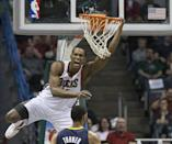 Milwaukee Bucks' Chris Wright reacts to his alley-oop dunk against the Indiana Pacers during the second half of an NBA basketball game on Wednesday, April 9, 2014, in Milwaukee. (AP Photo/Tom Lynn)