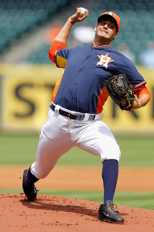 Houston's Mark Appel throws in the first inning of a spring exhibition baseball game against Rojos del Aguila de Veracruz on Sunday, March 30, 2014, in Houston. (AP Photo/Bob Levey)