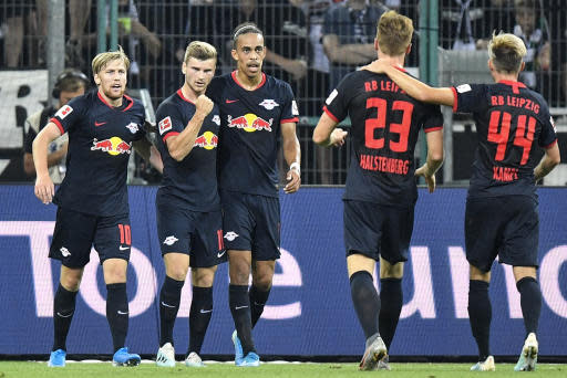 Leipzig's Timo Werner, 2nd from left, celebrates with his team after he scored the opening goal during the German Bundesliga soccer match between Borussia Moenchengladbach and RB Leipzig in Moenchengladbach, Germany, Friday, Aug. 30, 2019. (AP Photo/Martin Meissner)