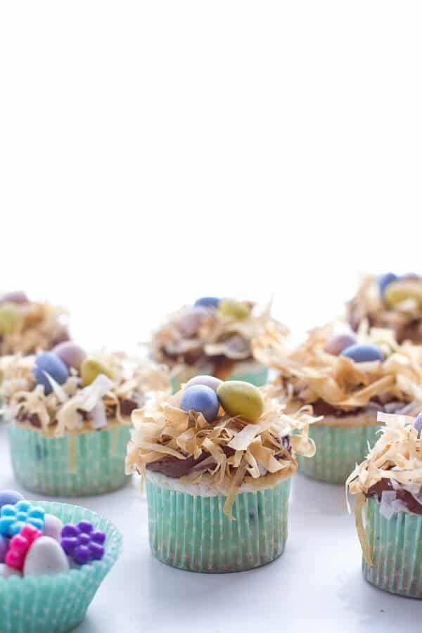 """<p>These little angel food cupcakes have a light and fluffy base with a decadent topping. The coconut flake bird nests topped with egg candies will animate your Easter table spread. </p><p>Get the full recipe from <a href=""""https://www.halfbakedharvest.com/angel-food-cupcakes-chocolate-whipped-coconut-frosting-crispy-phyllo-nest/"""" rel=""""nofollow noopener"""" target=""""_blank"""" data-ylk=""""slk:Half Baked Harvest"""" class=""""link rapid-noclick-resp"""">Half Baked Harvest</a>. </p>"""