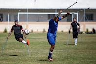 One player said that after he was wounded, playing football helped him 'psychologically and physically' and made him 'happy'