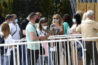 People wait in line to enter the COVID-19 vaccination center, at A1 Arena in Skopje, North Macedonia, on Tuesday, May 4, 2021. The European Union started delivering EU-funded coronavirus vaccines Tuesday to the Balkans, a region that wants to join the 27-nation bloc but where China and Russia have already been supplying the much-needed shots and making political gains. (AP Photo/Boris Grdanoski)