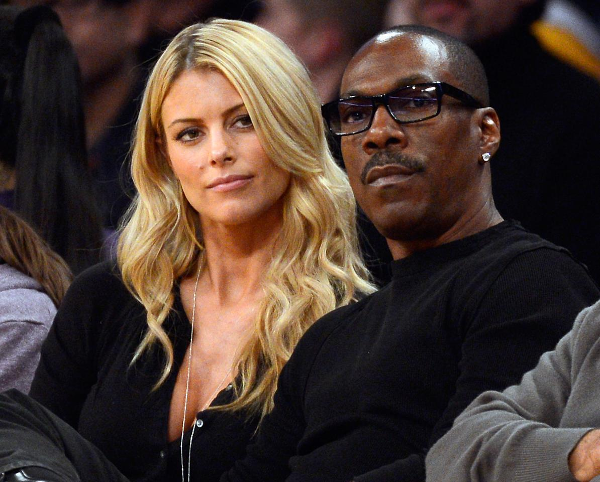 Paige Butcher and Eddie Murphy attend the Lakers and Suns game at Staples Center in 2012.