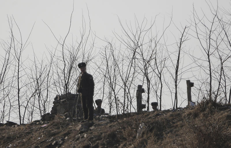 North Korean soldiers stand guard on the river bank of the North Korean town of Sinuiju, opposite side of Dandong, China on Wednesday Feb. 6, 2013. North Korea vowed last month to carry out its third nuclear test but has said nothing about timing. (AP Photo/Eugene Hoshiko)