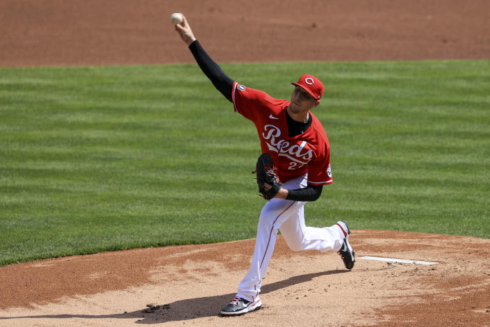 Cincinnati Reds' Jeff Hoffman throws during the first inning of a baseball game against the St. Louis Cardinals in Cincinnati, Sunday, April 4, 2021. (AP Photo/Aaron Doster)