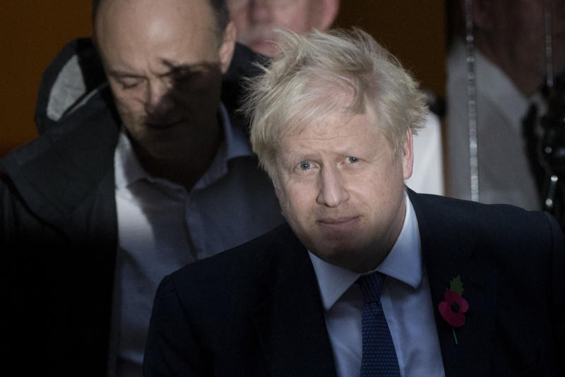 British Prime Minister Boris Johnson and his advisor Dominic Cummings, left, leave 10 Downing Street in London, and get in a car together to go to the Houses of Parliament, Monday, Oct. 28, 2019. British Prime Minister Boris Johnson says it's Parliament's fault, not his, that Britain will not be leaving the European Union as scheduled on Oct. 31. The EU has agreed to postpone Brexit until Jan. 31, 2020, after Johnson failed to get British lawmakers to ratify his divorce deal with the bloc in time to leave this week. (AP Photo/Matt Dunham)