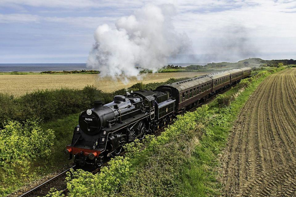 "<p>One of Britain's best heritage railways is the North Norfolk Railway, or the Poppy Line as it is also known. </p><p>The relaxed train journey takes passengers from Sheringham along the coast to Weybourne and through beautiful heathland to Holt.</p><p>Its steam trains are run by volunteers and offer a slow-paced holiday in Norfolk. At Sheringham Station, you'll want to check out the 1950s' waiting room and restored signal box.</p><p><strong>Ride the Poppy Line on Good Housekeeping's tour of Norfolk with former royal correspondent Jennie Bond, or try a Norfolk rail holiday including exclusive entrance to Felbrigg Hall, with great train journeys starting from £495 per person. </strong></p><p><a class=""link rapid-noclick-resp"" href=""https://www.goodhousekeepingholidays.com/tours?locations%5Bsearch%5D=Norfolk%2C+UK&locations%5Bgeo%5D=52.355367%2C0.153555%2C52.992704%2C1.745461"" rel=""nofollow noopener"" target=""_blank"" data-ylk=""slk:FIND OUT MORE"">FIND OUT MORE</a></p>"