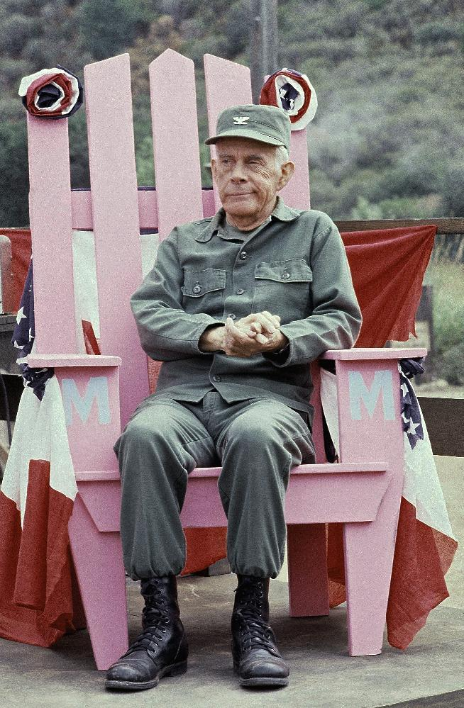 "FILE - In this Sept. 19, 1982 photo, Actor Harry Morgan sits on the set of  ""M*A*S*H*"" in Los Angeles.   The Emmy-winning character actor whose portrayal of the fatherly Col. Potter on television's ""M*A*S*H"" highlighted a show business career that included nine other TV series, 50 films and the Broadway stage, died Wednesday, Dec. 7, 2011. He was 96.  Morgan appeared in mostly supporting roles on the big screen, playing opposite such stars as Henry Fonda, John Wayne, James Garner, Elvis Presley and Dan Aykroyd. On television, he was more the comedic co-star, including roles on ""December Bride,"" its spin-off ""Pete and Gladys,"" as Sgt. Joe Friday's loyal partner in later ""Dragnet"" episodes and on CBS-TV's long-running ""M-A-S-H"" series, for which he earned an Emmy award in 1980.    (AP Photo/Wally Fong)"
