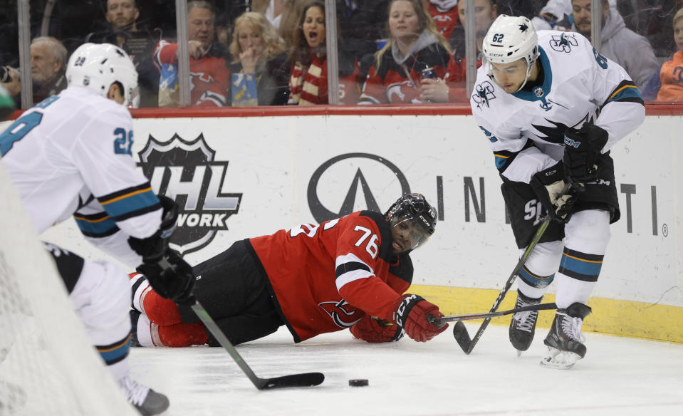 San Jose Sharks right wing Kevin Labanc (62) watches as San Jose Sharks right wing Timo Meier (28) takes control of the puck after New Jersey Devils defenseman P.K. Subban (76) fell on the ice during the first period of an NHL hockey game, Thursday, Feb. 20, 2020, in Newark, N.J. (AP Photo/Kathy Willens)