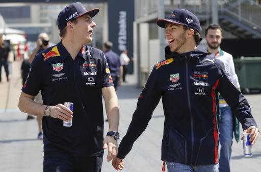 Red Bull's Pierre Gasly of France, right, and Max Verstappen of the Netherlands talk before the first free practice at the Baku Formula One city circuit, in Baku, Azerbaijan, Friday, April 26, 2019. The Formula One race will be held on Sunday. (AP Photo/Sergei Grits)
