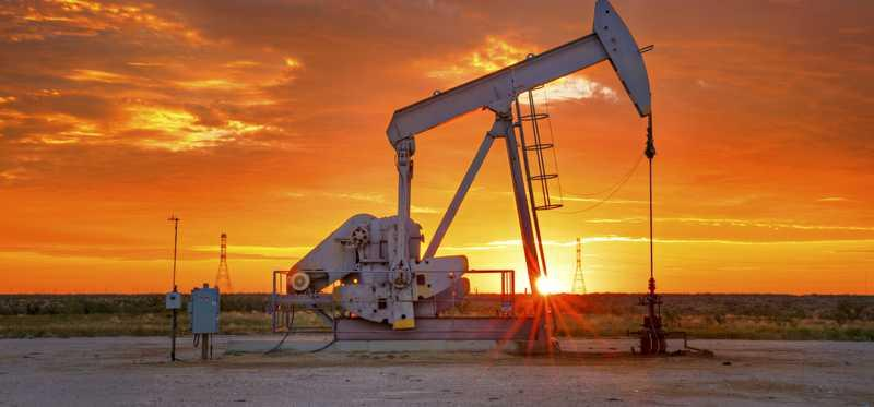 An oil pump amid a Texas sunrise.