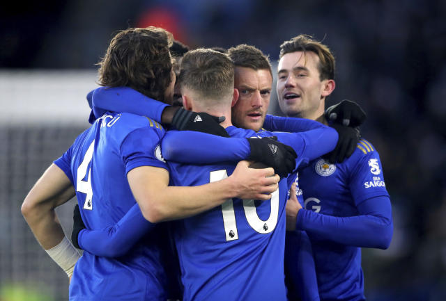 Leicester City's Jamie Vardy, 2nd right, celebrates after Norwich City goalkeeper Tim Krul scored an own goal, during their English Premier League soccer match at King Power Stadium in Leicester, England, Saturday Dec. 14, 2019. (Nick Potts/PA via AP)