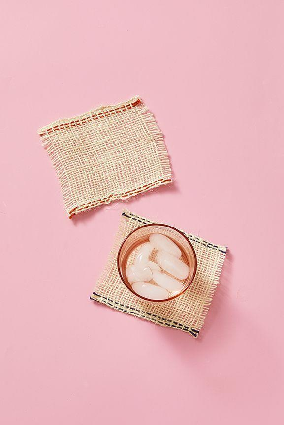 """<p>To make sweet coasters that will remind guests of their Easter baskets, cut a 5-inch square of burlap. Use a needle to carefully remove the threads around the edge of the square to create a fringe texture. Thread the needle with a contrasting yarn or embroidery thread and stitch a line along the sides of the burlap. </p><p><a class=""""link rapid-noclick-resp"""" href=""""https://www.amazon.com/Laribbons-Burlap-Fabric-Craft-Ribbon/dp/B0046UV3CO?tag=syn-yahoo-20&ascsubtag=%5Bartid%7C10055.g.2217%5Bsrc%7Cyahoo-us"""" rel=""""nofollow noopener"""" target=""""_blank"""" data-ylk=""""slk:SHOP BURLAP"""">SHOP BURLAP</a></p>"""