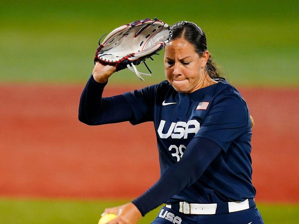 United States' Cat Osterman pitches during the first inning of a softball game against Japan at the 2020 Summer Olympics.