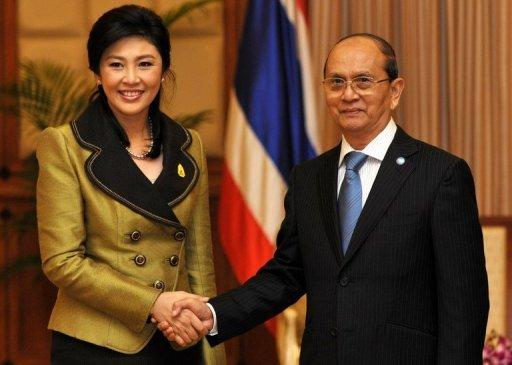 Thailand's Prime Minister Yingluck Shinawatra (left) shakes hands with Myanmar President Thein Sein during a meeting in Cambodia's Siem Reap province on July 13. Thein Sein has made his first official trip to Thailand since taking power in a visit likely to focus on economic ties between his reforming nation and its more affluent neighbour